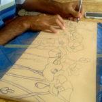 preparazione del disegno sul supporto dove realizzare il mosaico